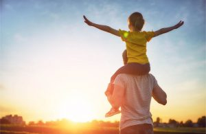 An Austin Texas dad is able to carry his son after stem cell therapy