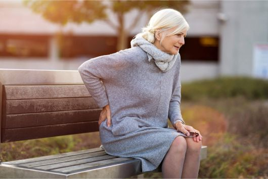 An older Dallas woman suffering with back pain