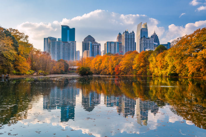 A view of Piedmont Park with downtown Atlanta, GA in the background