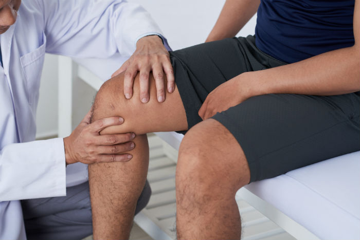 A Lubbock doctor examining a patient's knee