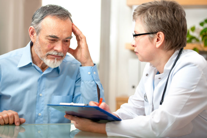 A Scottsdale man sees his doctor for migraines