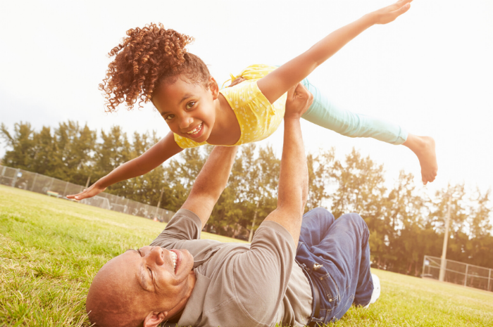 A St. Louis father lifts up daughter