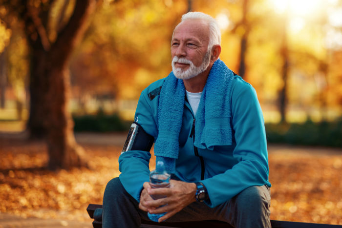 A senior Fort Wayne man rests on a bench after a run