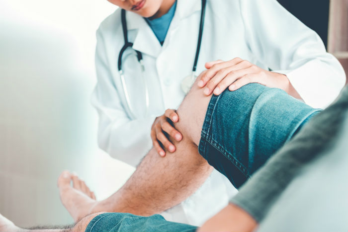 Doctor addresses a man's knee pain