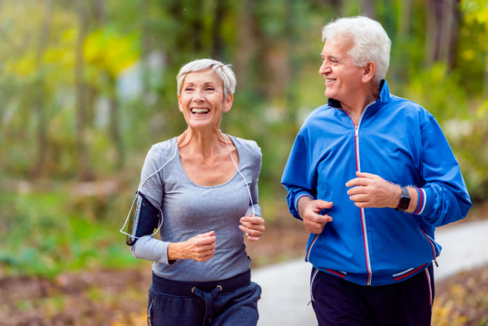A senior St. Petersburg couple happily runs together