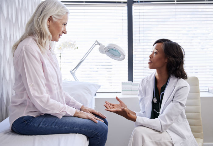 A woman sees her doctor to discuss stem cell therapy