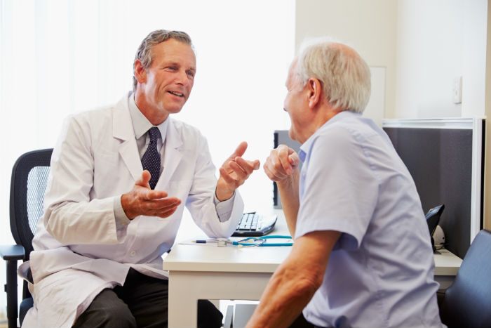 Elderly man sees a doctor for a stem cell consultation