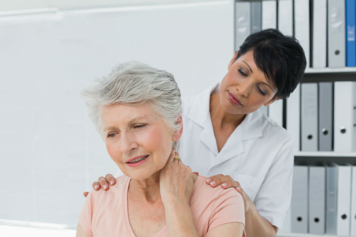 A Madison woman sees  her doctor for neck pain