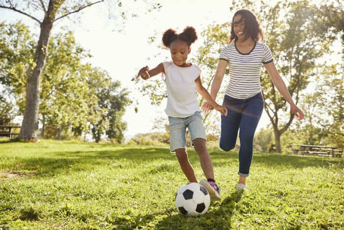 A Mobile, AL mother playing soccer with daughter