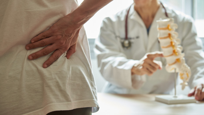 Doctor sees patient with shoulder pain