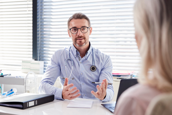 A patient consults with a doctor about stem cell therapy