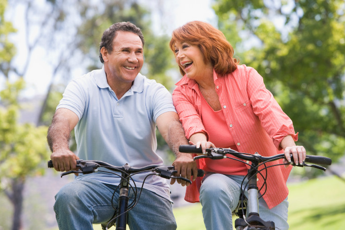 Mature Brownsville couple riding bikes together